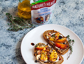 grilled peach tartine with blueberries almond and goji